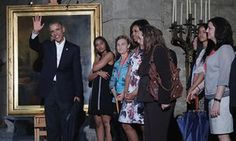 Barack Obama along with Michelle, Malia and Sasha stop to look at a painting of Abraham Lincoln in the Museum of the City of Havana.