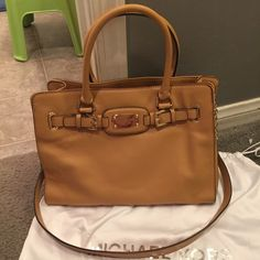 Michael kors hamilton NWOT!!!! 100% authentic, smoke free, dustbag not included, no flaws at all in excellent condition, color is peanut. price listed is not actual asking price i am Open to offers, just don't low ball me.  Michael Kors Bags Satchels