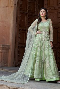 Gratifying green designer lehenga style suit online which is crafted from net fabric with exclusive embroidery and hand work. This stunning designer lehenga style suit comes with banglori satin bottom, net dupatta and japan satin, american crepe inner. Long Choli Lehenga, Bridal Lehenga Choli, Ghagra Choli, Anarkali Lehenga, Silk Lehenga, Anarkali Suits, Lehenga Suit, Punjabi Suits, Saris
