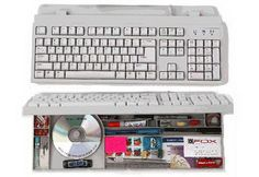 This hollow computer keyboard provides a good place to store little items. http://hative.com/clever-hidden-storage-ideas/