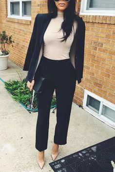 a women wearing a black blazer and nude turtleneck with black slacks and nude pointy toe pumps