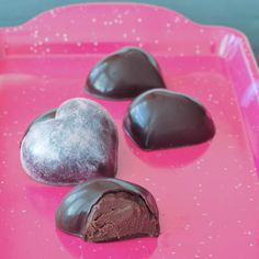Heart-shaped Dark Chocolate Mint Truffles are perfect for Valentine's Day! Plus, only three ingredients! 8 ounces dark chocolate, divided 1/2 cup full fat coconut milk (canned)* 8-10 drops (1 dropper full) Peppermint NuStevia