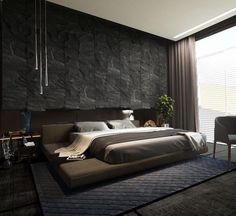 Modern master bedroom with stone walls and dark colors