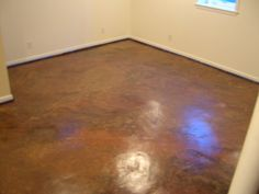 Get the look of stained concrete floors with paint, polyurethane and plastic bags!