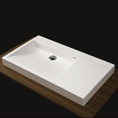 Need a full top washbasin with flat side area (for soap dish, cup).  I don't want any cabinet area exposed (for water damage purposes).  Lacava ($810) 5101 Luce Washbasin
