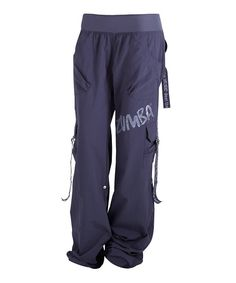 """Slip on these cargo pants before heading to class and revel in the instant charge of stylish energy they're sure to provide. The relaxed fit keeps them loose enough to groove, yet sleek enough to captivate, while snaps and D-ring ties allows Zumba®lovers to create a custom, funky-fresh look.Measurements (size S): 34"""" inseam, 5 1/2"""" front rise, 10"""" back rise"""