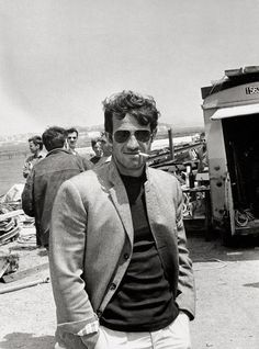 Jean-Paul Belmondo on the set of Pierrot le fou directed by Jean-Luc Godard , 1965. Photo by Tony Grylla