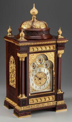 A Moorish Revival Mahogany and Gilt Bronze Mantle Clock for Tiffany & Co., New York, New York, circa 1884. Marks to dial: TIFFANY & CO