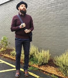 This weather might have us shedding our layers but no reason you can't still walk around in style. Hat: @bailey_hats Sweater/Bag: @aheritageofmodernism Shirt: @stoneroseshirts Watch: @nixon_now Pants: @ted_baker Shoes: @jshoes