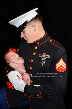 A US Marine Father with his Princess! Newborn 2013 of www.davinalovelyphotojournal.com
