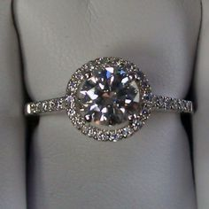 """Respected by brides, halo gemstone diamond engagement rings certainly are a signature kind of Ritani. Halo rings possess a central round stone encircled having a """"halo"""" of smaller sized sized diamo… Halo Engagement Rings, Wedding Engagement, Wedding Bands, Wedding Ring, Bling Bling, Just In Case, Just For You, Ring Verlobung, Hand Ring"""