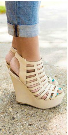 "Kick off the season with our Valerie Wedge Sandal. Strappy sandal in nude. Peeptoe. Inside zip. Heel: 5""."