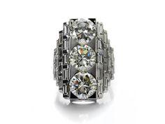 Ringweite: 54. Ringkopflänge: ca. 2,6 cm. Gewicht: ca. 18,2 g. WG 750. Eine Expertise von IGN ist vorhanden. Prächtiger hochwertiger Ring mit drei grossen...