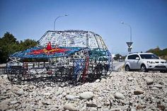 "The Hanger Artcar is a tribute to an iconic local ""Art Car"" created by Angus Greig from a Toyota Corolla, which was painted up by various artists. South African Art, Land Art, Toyota Corolla, Various Artists, Sculpture Art, 1980s, Hanger, Car, Clothes Hanger"