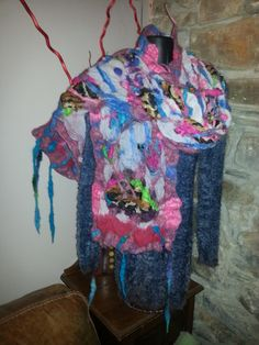 Cotton and silk nuno felted with various wools to create this stunning wrap.