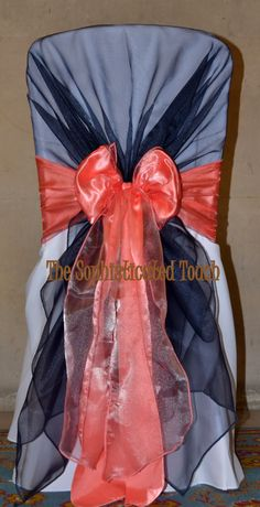 Navy Organza Shawl with a double Coral Organza and Peach Satin Bow on a White Chair Cover The Sophisticated Touch ...Chair Covers by Design