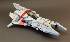 https://flic.kr/p/7iZ56M   G4 Harpy   Dunno if it qualifies as a Vic Viper, but it started out as one. Looks more like a weird version of a Jedi starfighter or maybe some other video game fighter.
