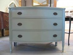Bow front dresser painted in ocean
