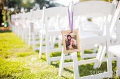 Photos of bride and groom line the wedding ceremony aisle. Stephanie Rose Events @capereycarlsbad
