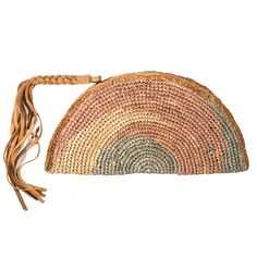 "- ""Ormond"" clutch in Adobo Multi pattern - Fringe tassle detail on zipper pull - Dimensions: 11.5'' x 7'' About Flora Bella: Flora Bella's philosophy is to provide the finest of handicraft resort wear"