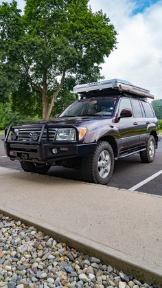This 2004 burgundy beauty received a number of upgrades to shift it to present day- both in look and functionality. Toyota Land Cruiser 100, Toyota Lc, Overland Truck, Electric Winch, Jerry Can, 4x4 Off Road, Suv Cars, Present Day, Car Pictures