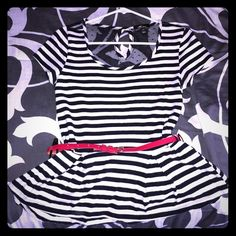 Stripped Peplum Top w/ Red Belt Black and white striped peplum shirt with back keyhole closure at neck. The back has a sheer black polkadot mesh. Red belt included. Looks great with our without belt. Has some stretch to it.  ❌trades ❌lowballs  offer button   Bundle 2 or more items and save 10%! Monteau Tops