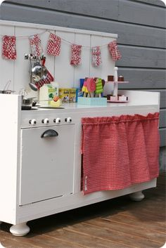 For the girls' bedroom this would be super fun and cute!!! - wood cabinet play kitchen