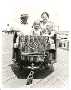 The Beckman Family in a rolling chair on the Boardwalk in 1937