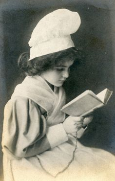 Edwardian girl reading.  Adorable