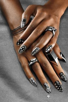 The Nail Art: 3-D, party on every nail: Using black and silver polish as a base. Carter designed a vastly different look for each nail. With artfully placed Swarovski crystals, silver chains, foil and spikes, this is not your mother's manicure.