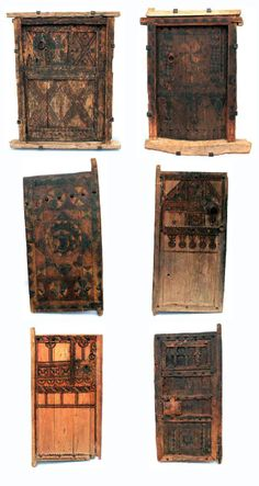 Africa |  Doors from Morocco | Wood | Some dating back to the 19th century  |  All are granary doors, except bottom left which is a 'Tarma'; an old interior door