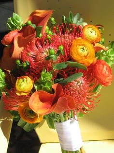 orange tropical wedding flower bouquet, bridal bouquet, wedding flowers, add pic source on comment and we will update it. www.myfloweraffair.com can create this beautiful wedding flower look.