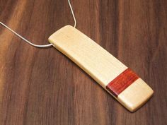 Bloodwood and Maple Necklace with Silver Chain. $30.00, via Etsy.