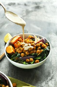 AMAZING Sweet Potato Chickpea Buddha Bowl with Kale, Red Onion, and a STUNNING Tahini-maple sauce! #vegan #glutenfree #healthy #minimalistbaker