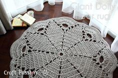 """Free pattern for a more solid doily rug, modified from the Poinsettia pattern.  Uses 7 pkgs of 7/32"""" x 200 ft cotton clothesline & an N hook; diameter is a generous 4 ft.  (It's noted that it takes a bit of hand/wrist/arm strength.)  Really good photos of how to join each hank to the next as you go.  I think I'd make this as a half-round.  #crochet"""