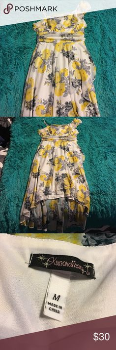 Beautiful dress Medium Beautiful preowned dress gray and yellow accent. Worn only once for a wedding. Size M. Goes perfect with grey BCBG heels 👠 you will find in my Posh closet. Xtraordinary Dresses High Low