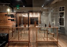 Chinese studio Neri has unmasked the I-beams of the oldest steel-framed building in Shanghai to create an Italian restaurant with a raw industrial interior.  The designers stripped the inside of the space, leaving exposed brickwork, peeling plaster and Victorian ceilings mouldings intact. The architects then added steel-framed partitions.