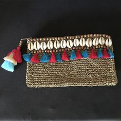 Fabulous summer beach boho clutch . Lots of different colours available .