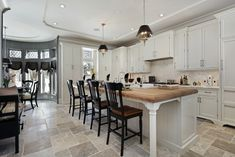 Long luxury custom kitchen in white with long white island