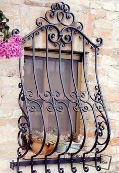 Decorative wrought iron windows protector adds beauty to plain windows.