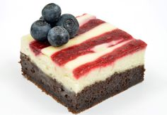 Stars and Stripes Cream Cheese Brownies are the perfect dessert to serve at your Fourth of July barbeque or picnic. The melt in your mouth brownie is finished off with blueberries and a delicious cream cheese and jam topping.