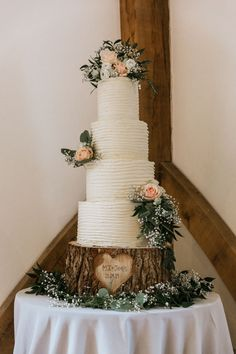 Four Tiered Wedding Cake With Rose Decor On Rustic Personalised Tree Slice
