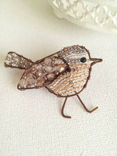 Beautiful handmade wire and beaded Wren bird Brooch available to buy from www.pollyred.co.uk
