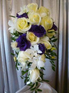 Cascade bouquet with White Roses, Purple Lisianthus, White Dendrobium Orchids and Italian Ruscus | Walden Floral Design