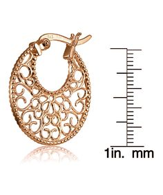 Rose Gold Filigree Round Hoop Earrings. - . $16.99 Compare at $40.00  . Product Description:  Exude elegance with these hoop earrings boasting a filigree design and a rose gold finish for dazzling appeal.      20.35 mm W x 21 mm L  .     18k rose gold-plated silver  .     Imported