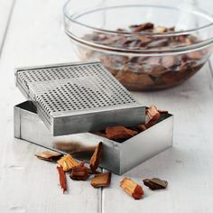 Mini Smoker Box  This handy little box proves that big flavor comes in small packages. Fill it with herbs or wood chips and it instantly turns any outdoor grill into a smoker, quickly infusing food with rich, fire-smoked flavor—from steaks and burgers to chicken, seafood, veggies or tofu.