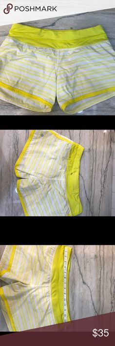 Lululemon run shorts! Bright yellow! Gorgeous bright yellow with liner.  I cannot find the size dot for the life of me.  I'm pretty sure they are an 8 - see measuring tape in last photo to confirm. Great condition! lululemon athletica Shorts