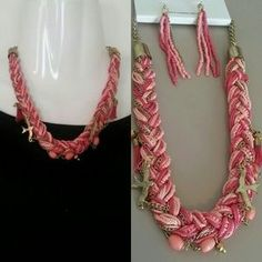 I just added this to my closet on Poshmark: Pink Charm Bib Necklace Braided Thread Detail. Price: $14 Size: OS