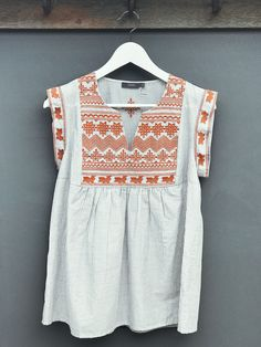 The gorgeous embroidered top has us in stitches   Snag this desert-inspired top for a boho look this spring!