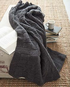 A simple blanket with a subtle basketweave pattern, this project is perfect for beginner knitters. (Yarnspirations)